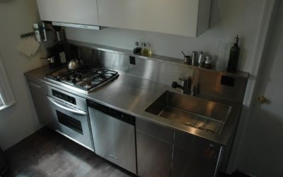 Custom Stainless Steel Countertop Waterfall Design for Compact Kitchen
